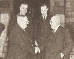 Handshake between William L. Phillips and Samuel W. McGinness